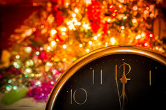 New Year Clock. With bokeh lights Royalty Free Stock Images