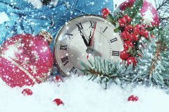 New Year clock with Christmas balls. And fir branches Royalty Free Stock Image