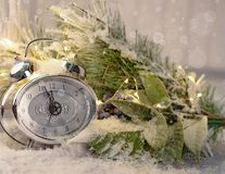 New year clock and cones covered with snow. Christmas and new year`s decor.  royalty free stock photos