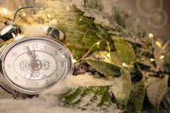 New year clock and cones covered with snow. Christmas and new year`s decor.  royalty free stock photography