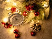 New year clock and cones covered with snow. Christmas and new year`s decor stock photography