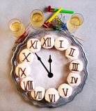 New Year clock cupcakes on salver. Top view Stock Images