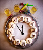 New Year clock cupcakes on salver. Top view Stock Photo