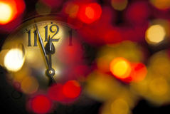 New year clock. A new year clock with dark unfocused background Stock Photos