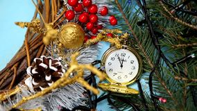 New year clock with decoration. Christmas decorations and empty space on a wooden background for Christmas and New Year stock video
