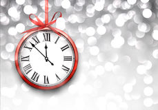 New year clock with defocused background. Royalty Free Stock Image