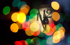 New year clock. Face of new year clock with colored decoration Stock Photography