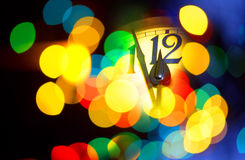 New year clock. Face of new year clock with colored decoration Royalty Free Stock Image