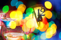 New year clock. Face of new year clock with wine glasses Royalty Free Stock Photo