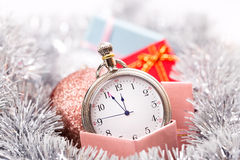 New year clock horizontal. New year clock on lights tinsel  background horizontal Royalty Free Stock Images