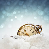 New year clock. Before midnight. Antique pocket watch in the snow Stock Photo