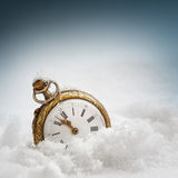 New year clock. Before midnight. Antique pocket watch in the snow Royalty Free Stock Photos