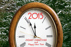 New year clock. With 2015 instead of number 12 on the background of snow-covered fir trees Royalty Free Illustration