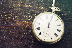 New year clock. Old pocket watch on a wooden background. Stock Photography