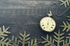 New year clock. Old pocket watch on a wooden background. Stock Photo