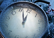 New Year clock powdered with snow. Royalty Free Stock Photo