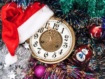 New year clock in red hat. New year clock with red hat and garland Stock Image