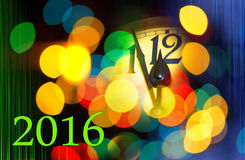 New year clock with text 2016. Face of new year clock with colored decoration and colored stripes, writing 2016 Stock Image