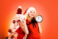 New Year clock and time christmas. Glamour celebration and Christmas woman dress. Merry christmas and Happy new year. New year gift stock photography