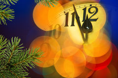 New Year Clock. With unfocused bauble in the night Stock Photos