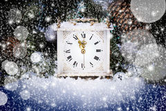 New year clock. Vintage new year clock over christmas tree with blue bokeh background Stock Photography