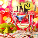 New year clock with wine glasses. Royalty Free Stock Image