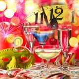 New Year Clock with Wine Glasses. And Confetti Stock Photography