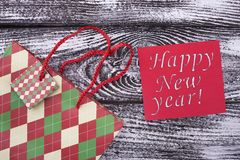 New Year color packet with congratulations. Happy New Year card. Preparation of a gift for the holiday stock photo