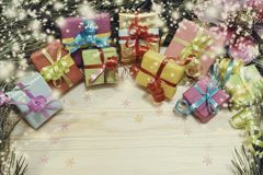 New-year colored boxes with gifts at a Christmas tree with cones Royalty Free Stock Image