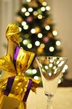 New year is coming. Waiting for new year to come with shampagne and christmas tree in a background stock photography