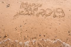 New Year 2019 is a concept - the inscription 2019 on a sandy beach stock photo