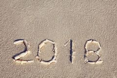 2018 laid out by seashells on the seashore stock images