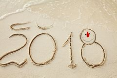 New Year 2018 is coming concept. wave coming to 2018 concept on the sand beach in the morning royalty free stock images