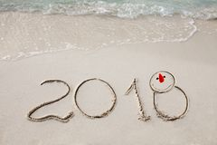 New Year 2018 is coming concept. wave coming to 2018 concept on the sand beach in the morning. royalty free stock photography