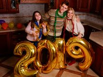 New 2019 Year is coming. Group of cheerful young people carrying gold colored numbers and have fun at the party.  stock image