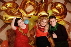 New 2019 Year is coming. Group of cheerful young people carrying gold colored numbers and have fun at the party royalty free stock photo