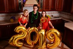 New 2019 Year is coming. Group of cheerful young people carrying. Gold colored numbers and have fun at the party royalty free stock photography