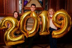 New 2019 Year is coming. Group of cheerful young people carrying royalty free stock photos