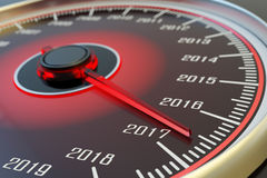 New year coming and passing time concept. Car dashboard speedometer dial with past years and arrow approach 2017 Royalty Free Stock Images