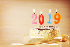New Year 2019 composition. Cake and burning candles Royalty Free Stock Images