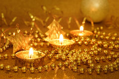 New Year composition with candles in golden shades Royalty Free Stock Photography