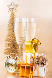 New Year composition with champagne and gifts on gold background royalty free stock images