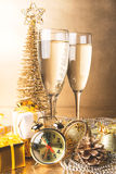 New Year composition with champagne and gifts Stock Photo