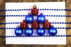 Christmas tree decorations on the table and sheet with music not Royalty Free Stock Photo