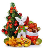 New year composition with christmas tree santa bag rabbit and mask Stock Photos