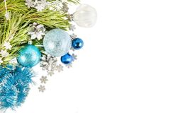 New Year composition with fir tree branch and cones with blue ba Royalty Free Stock Photos