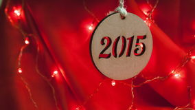 New Year 2015 - composition of garlands on a red stock video footage