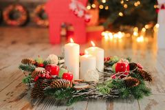 New Year composition. Holiday decorations and burning candles. Of christmas candle Stock Image