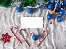 New Year composition. Made of Christmas balls , Christmas tree decorations and candy canes royalty free stock photography