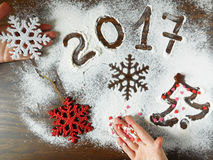 New Year composition made of flour and christmas decorations. New Year composition made of flour, christmas decorations and confectionery sprinkling lying on a stock photography